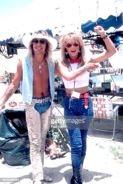 Singer Vince Neil of Motley Crue and actress Heather Thomas at Farm Aid 2 in Austin Texas July 4 1986