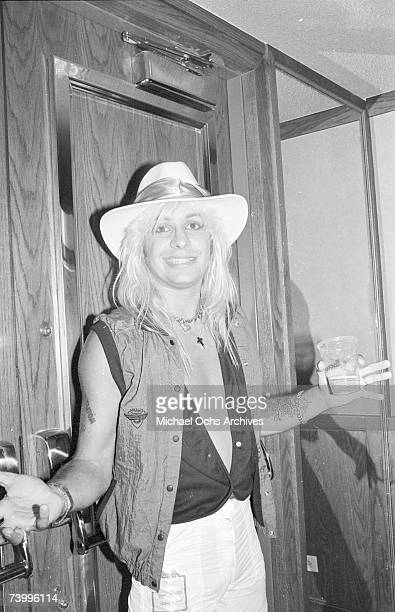 Singer Vince Neil of the Heavy Metal Band Motley Crue poses backstage at a Quiet Riot concert at the Forum on September 29 1984 in Inglewood...