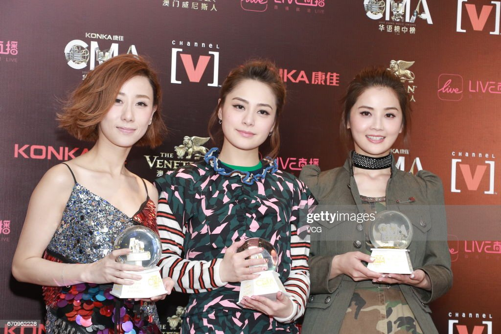 Singer Vincy Chan, Gillian Chung and Charlene Choi of girl group Twins pose with their trophies at backstage during the 21st China Music Awards on April 20, 2017 in Macao, China.