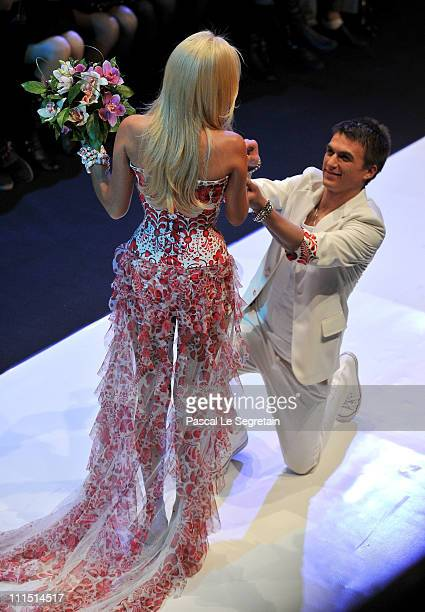 Singer Vlad Tepalov and model Victoria Lopyreva wear creations by designer YanaStasia on day 5 of the Mercedes-Benz Fashion Week Russia Fall/Winter...