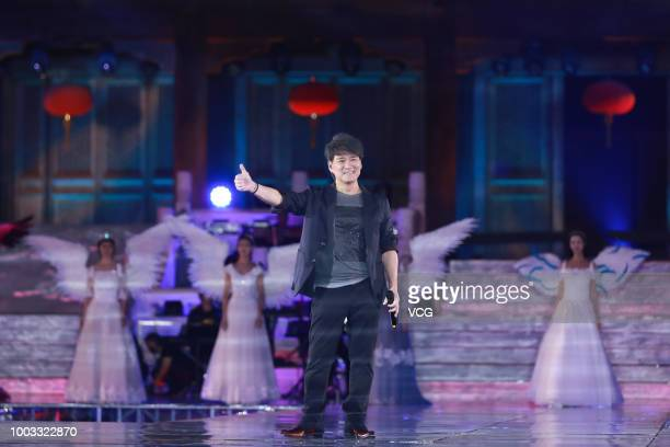 Singer Wakin Chau performs onstage during the opening ceremony of the 4th Annual International Jackie Chan Action Movie Week at Datong Prince's...