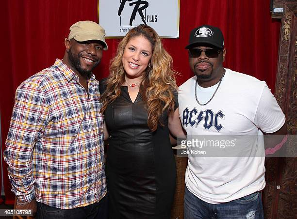 Singer Wanya Morris actress Lizza Monet Morales and singer Nathan Morris attend the GRAMMY Gift Lounge during the 56th Grammy Awards at Staples...
