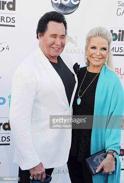 Singer Wayne Newton and Kathleen McCrone arrive at the 2013 Billboard Music Awards at the MGM Grand Garden Arena on May 19 2013 in Las Vegas Nevada