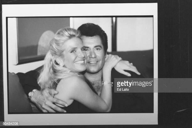 Singer Wayne Newton posing cheektocheek w his fiancee Kathleen McCrone in hotel room during his visit to perform at Rural Flood Relief concert