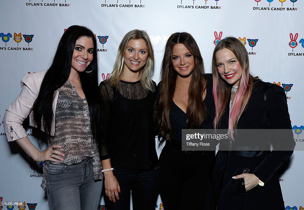 Singer Wendy Starland (2nd from R) and guests attend the Dylan's Candy BarN launch event at Dylan's Candy Bar on December 8, 2015 in Los Angeles, California.