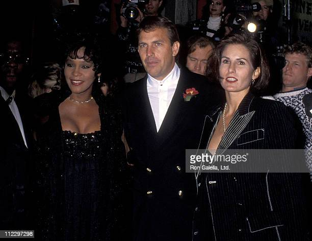 Singer Whitney Houston actor Kevin Costner and wife Cindy Costner attend 'The Bodyguard' Hollywood Premiere on November 23 1992 at Mann's Chinese...