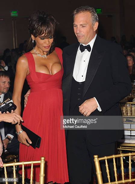 Singer Whitney Houston and actor Kevin Costner at Muhammad Ali's Celebrity Fight Night XIV at the JW Marriott Desert Ridge Resort Spa on April 5 2008...
