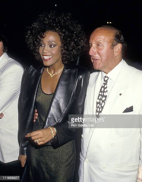 Singer Whitney Houston and Arista Records President Clive Davis attend a private party after her concert performance at Madison Square Garden on...