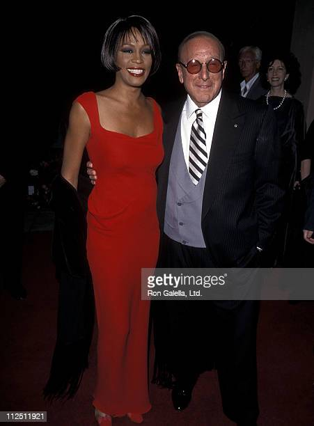 Singer Whitney Houston and Arista Records president Clive Davis attend the 41st Annual Grammy Awards PreParty Hosted by Clive Davis on February 23...