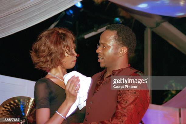 Singer Whitney Houston and Bobby Brown attend the rebirth of the Ocean Club Resort on December 9 2000 in Paradise Island Bahamas