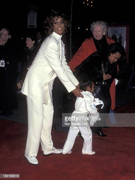 Singer Whitney Houston and daughter Bobbi Kristina Brown attend The Preacher's Wife New York City Premiere on December 9 1996 at the Ziegfeld Theater...