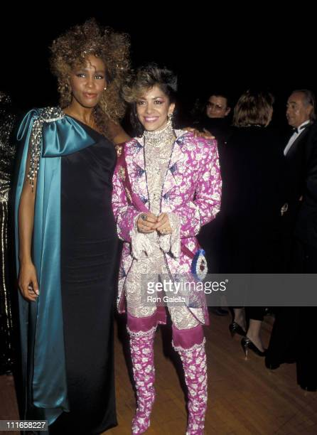 Singer Whitney Houston and musician Sheila E attend the 13th Annual American Music Awards on January 27 1986 at Shrine Auditorium in Los Angeles...