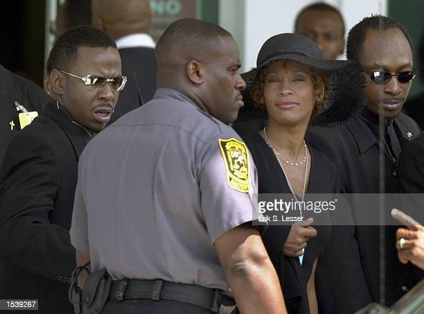 Singer Whitney Houston arrives to attend the public funeral for singer Lisa Left Eye Lopes at the New Birth Missionary Baptist Church May 2 2002 in...