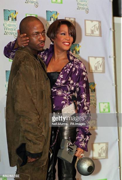US singer Whitney Houston hugs her husband Bobby Brown after she received the award for Best Rhythm and Blues performer at the 1999 MTV Europe Awards...