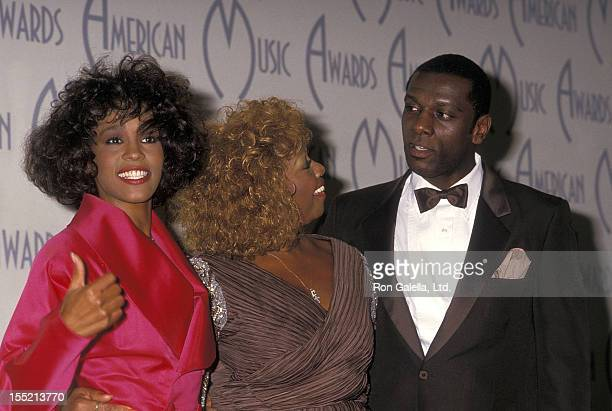 Singer Whitney Houston mother Cissy Houston and halfbrother Gary Garland attend the 15th annual American Music Awards on January 25 1988 at Shrine...