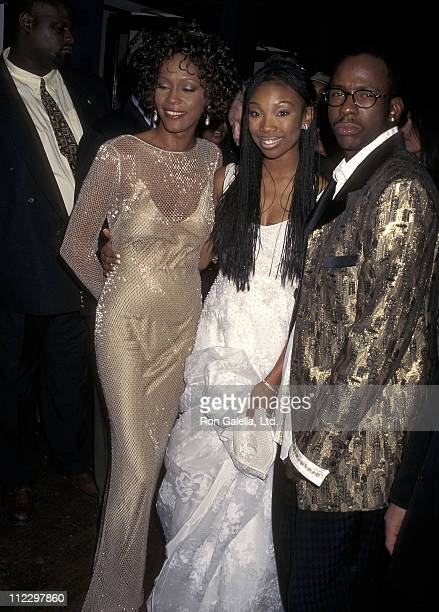 Singer Whitney Houston singer Brandy and singer Bobby Brown attend the Screening of Walt Disney Television ABC Present Cinderella on October 13 1997...
