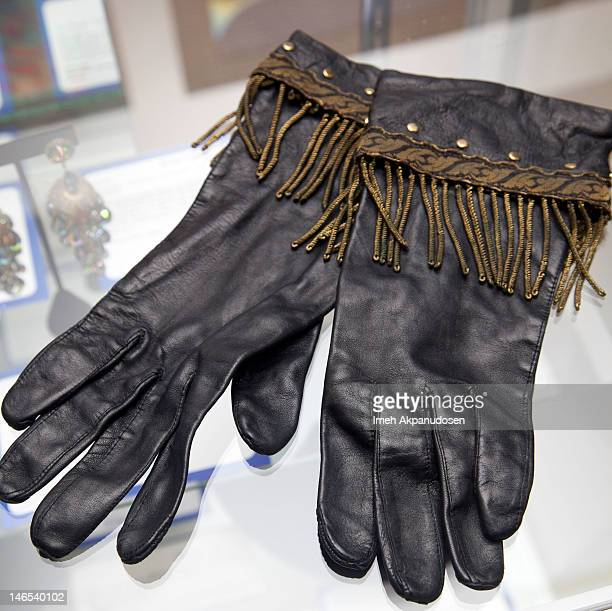 Singer Whitney Houston's 'Greatest Love of All' video gloves on display during the Music Icons And Sports Legends Memorabilia Auction Press Call at...