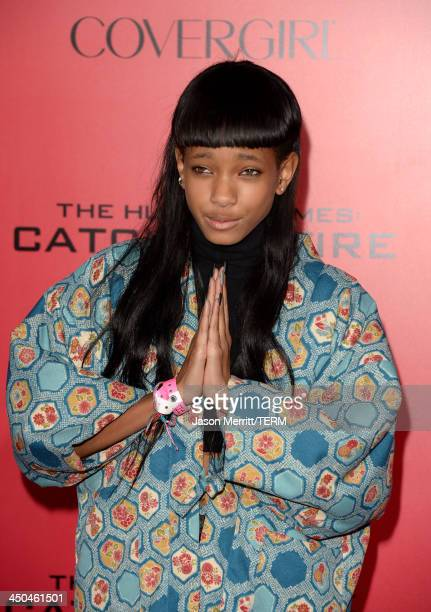 Singer Willow Smith arrives at the premiere of Lionsgate's The Hunger Games Catching Fire at Nokia Theatre LA Live on November 18 2013 in Los Angeles...