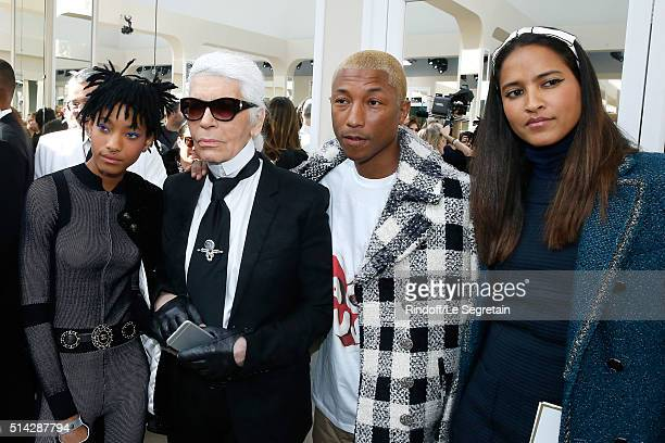 Singer Willow Smith designer Karl Lagerfeld Singer Pharrell Williams and his wife Helen Lasichanh attend the Chanel show as part of the Paris Fashion...