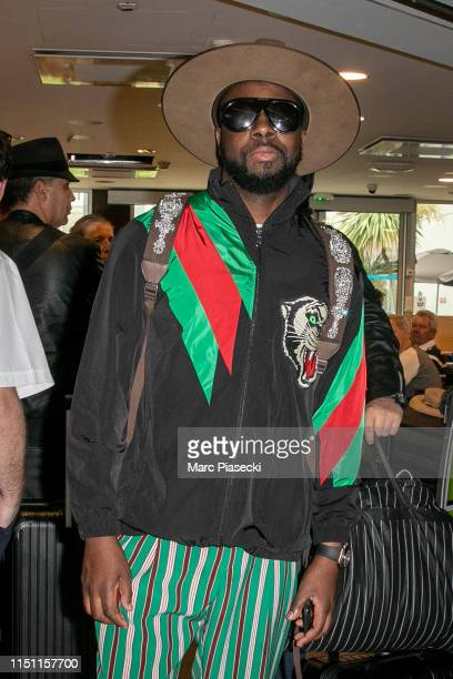 Singer Wycleaf Jean arrives ahead the 72nd annual Cannes Film Festival at Nice Airport on May 23 2019 in Nice France