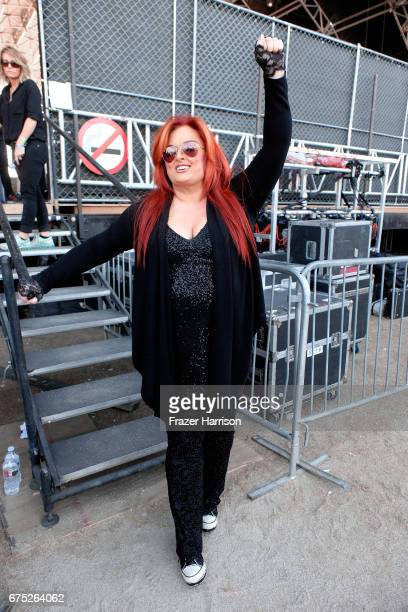 Singer Wynonna Judd of Wynonna the Big Noise poses backstage during day 3 of 2017 Stagecoach California's Country Music Festival at the Empire Polo...