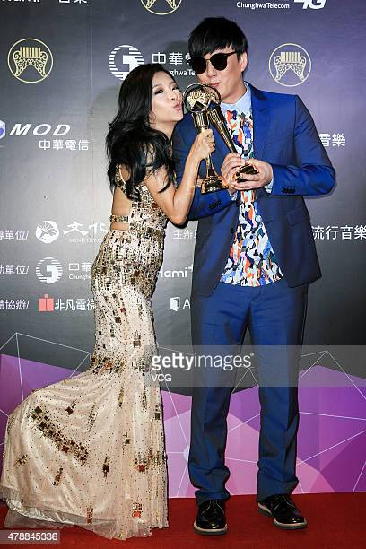 Singer Xiao HuangChi and singer Angie Lee pose with the trophies at backstage during 26th Golden Melody Awards at Taipei Arena on June 27 2015 in...
