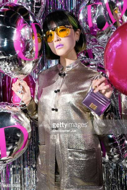 Singer YJY attends the Dior Addict Lacquer Plump Party at 1 OAK on April 10 2018 in Tokyo Japan
