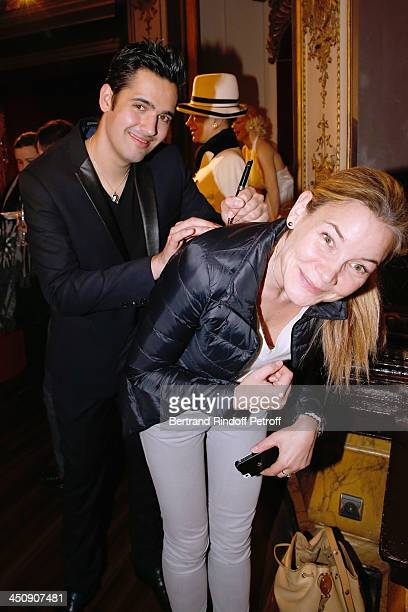 Singer Yoann Freget signing autograph at Coca Cola Christmas Father Waxwork Unveiling Event at Musee Grevin on November 20 2013 in Paris France