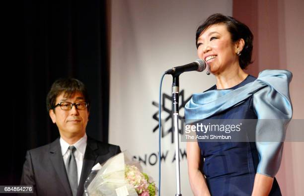 Singer yumi Matsutoya and her husband Masataka Matsutoya are seen on stage during the Snow Awards hosted by the Ski Association of Japan on May 18,...