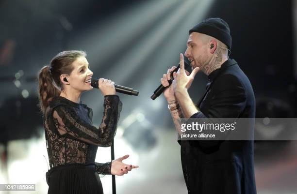 Singer Yvonne Catterfeld and contestant Boris Alexander Stein on stage with John Legend during the finale of the Sat1 talent show The Voice of...