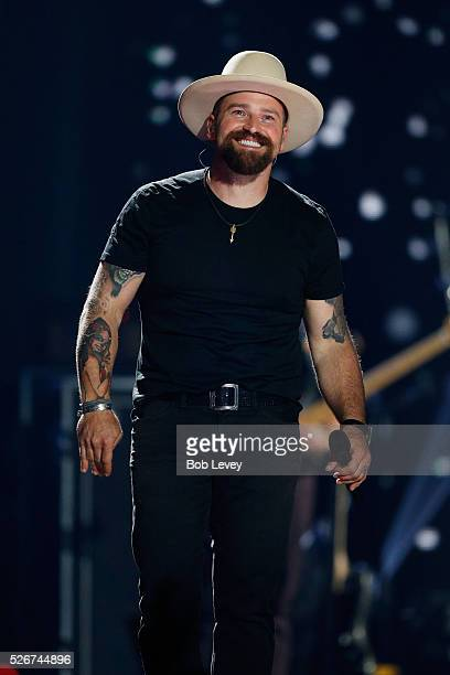 Singer Zac Brown speaks onstage during the 2016 iHeartCountry Festival at The Frank Erwin Center on April 30 2016 in Austin Texas