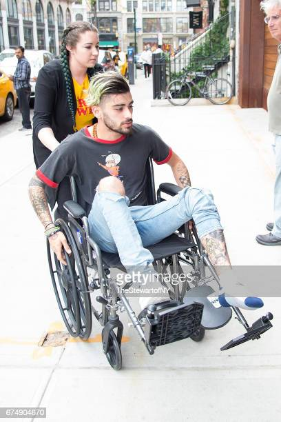Singer Zayn Malik is seen in a wheelchair in NoHo on April 29 2017 in New York City