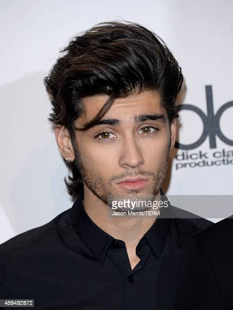 Singer Zayn Malik of One Direction winners of Artist of the Year Favorite Pop/Rock Band/Duo/Group and Favorite Pop/Rock Album poses in the press room...