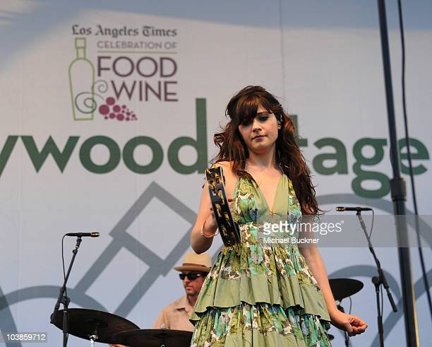 Singer Zooey Deschanel of She and Him performs at the Los Angeles Times Celebration of Food Wine at Paramount Studios on September 5 2010 in Los...