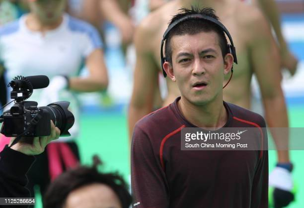 Singeractor Edison Chen Koonhei is surrounded by the media after he passed the finishing line at Victoria Park Causeway Bay during the Standard...