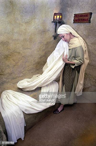 Singeractor Iris Reynolds rehearse a scene at the replica of the tomb of Jesus Christ at the Holy Land Experience in Orlando Florida 30 January 2001...