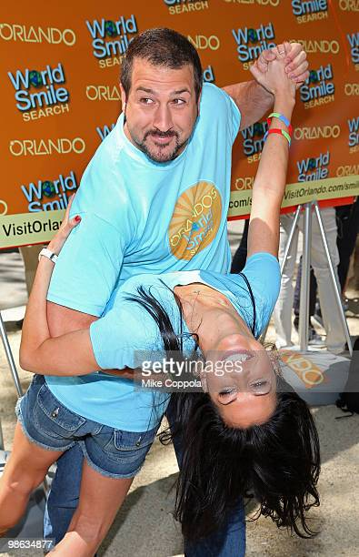 Singer/actor Joey Fatone dips television personality Melissa Rycroft at Smile Train's World Smile Search in Madison Square Park on April 23 2010 in...