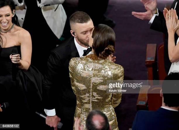 Singer/actor Justin Timberlake kisses actor Jessica Biel while performing onstage during the 89th Annual Academy Awards at Hollywood Highland Center...