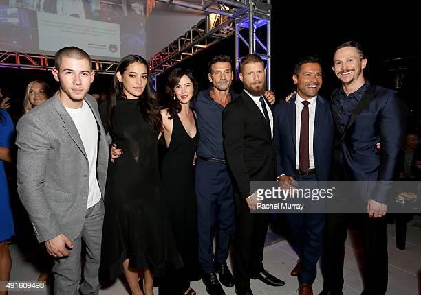 Singer/actor Nick Jonas actors Natalie Martinez Joanna Going Frank Grillo Matt Lauria Mark Consuelos and Jonathan Tucker celebrate the season...