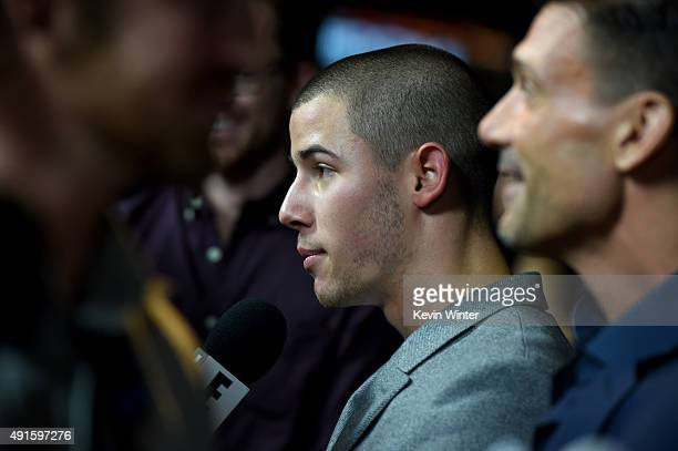 Singer/actor Nick Jonas and actor Frank Grillo attend the premiere of DIRECTV's Kingdom Season 2 at SilverScreen Theater at the Pacific Design Center...