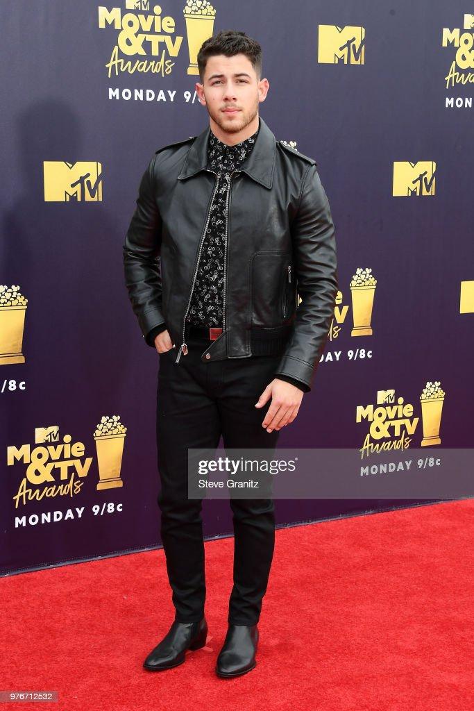 Singer/actor Nick Jonas attends the 2018 MTV Movie And TV Awards at Barker Hangar on June 16, 2018 in Santa Monica, California.