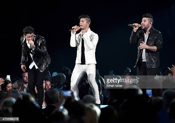 Singer/actor Nick Jonas musicians Dan Smyers and Shay Mooney of Dan Shay perform onstage during the 50th Academy of Country Music Awards at ATT...