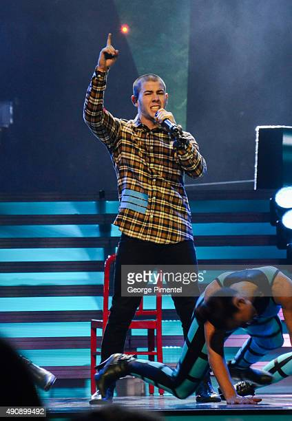 Singer/actor Nick Jonas performs at We Day Toronto at the Air Canada Centre on October 1 2015 in Toronto Canada