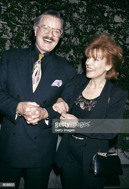 Singer/actor Robert Goulet and his wife Vera Novak laugh outside Spago's restaurant April 23 2001 in Los Angeles CA