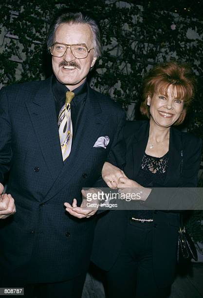 Singer/actor Robert Goulet and his wife Vera Novak smile outside Spago's restaurant April 23 2001 in Los Angeles CA
