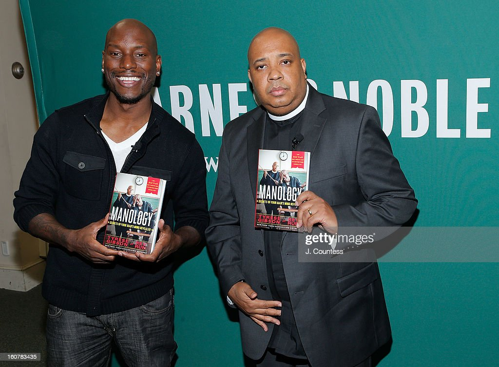 """Rev Run And Tyrese Gibson Sign Copies Of Their Book """"Manology: Secrets of a Man's Mind Revealed"""""""