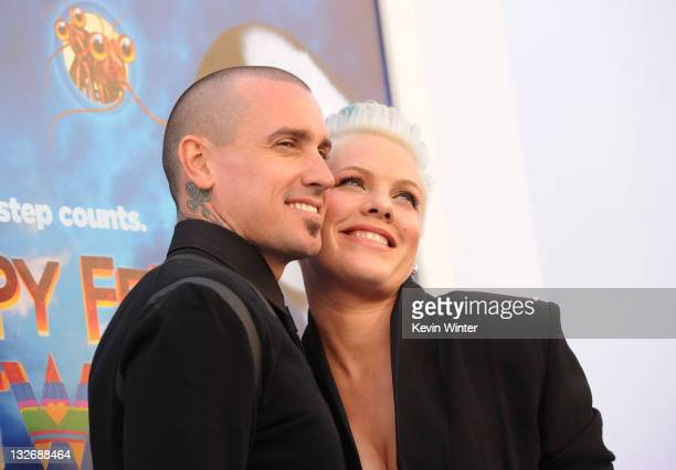 Singer/actress Alecia Beth Moore aka Pink and Carey Hart attend the Premiere of Warner Bros Pictures' 'Happy Feet Two' at Grauman's Chinese Theatre...