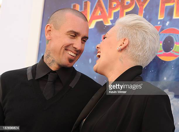 Singer/actress Alecia Beth Moore and Carey Hart attend the Premiere of Warner Bros Pictures' 'Happy Feet Two' at Grauman's Chinese Theatre on...