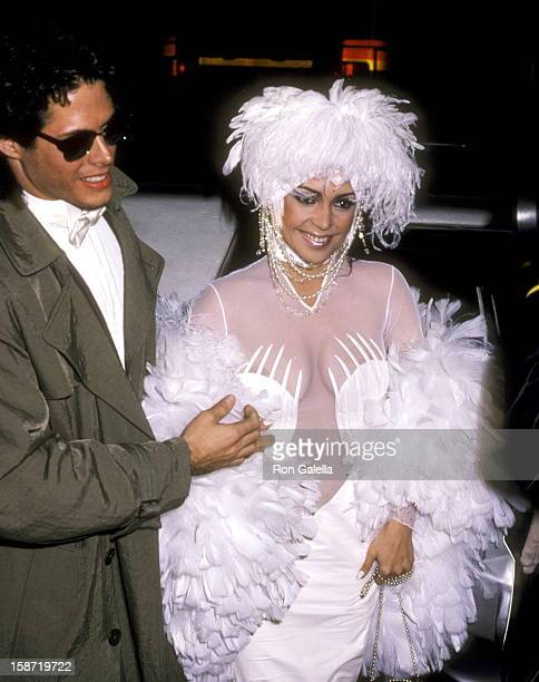 Singer/Actress Apollonia Kotero and date actor Kevin Bernhardt attend the Fourth Annual American Video Awards on November 20 1985 at Wiltern Theatre...