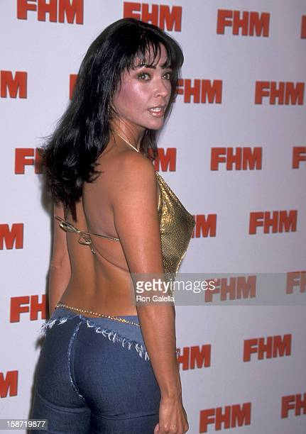 Singer/Actress Apollonia Kotero attends the FHM Salutes the 100 Sexiest Women in the World on May 17 2001 at La Boheme in West Hollywood California